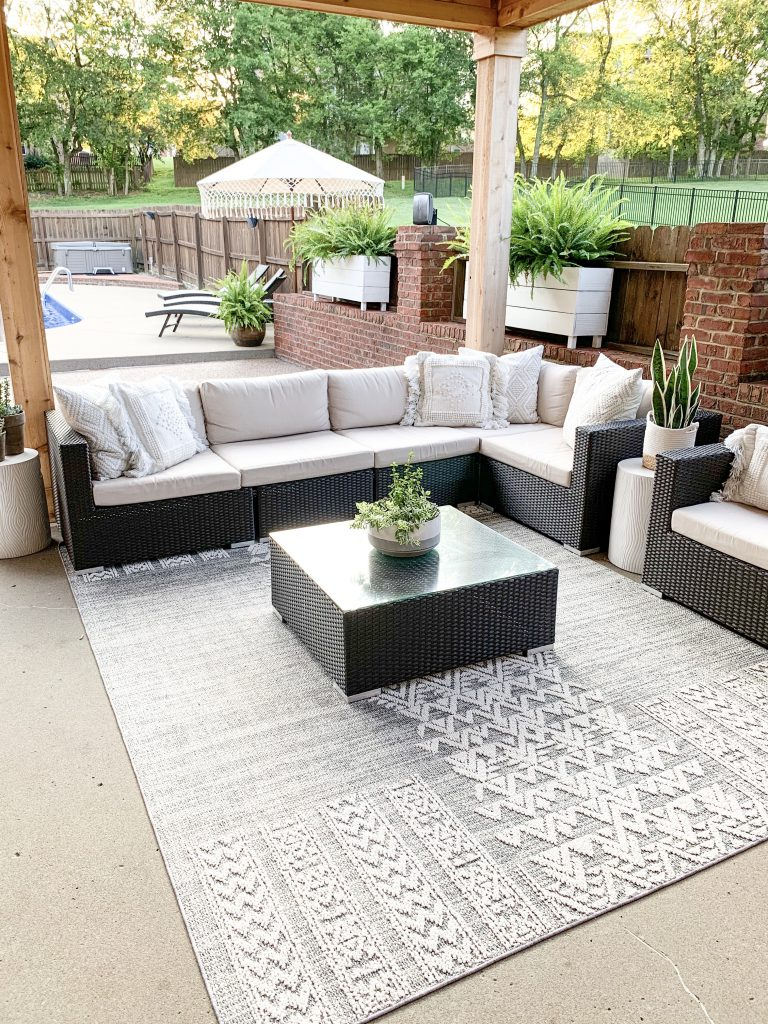 outdoor rug from Boutique Rugs under covered porch