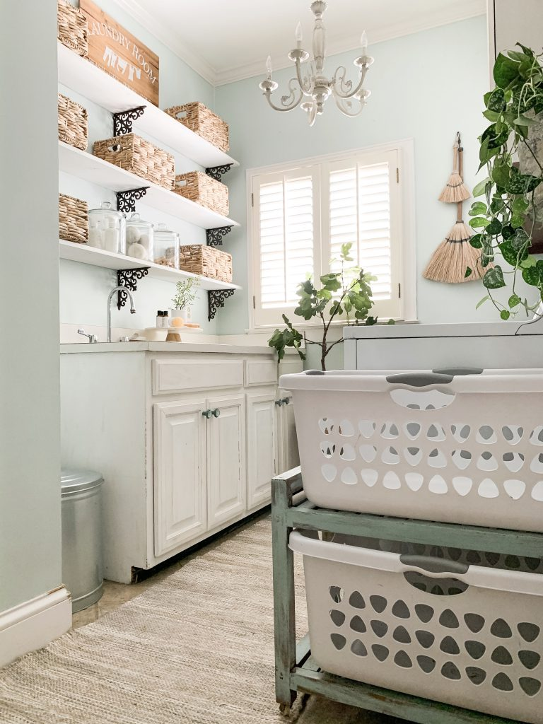 laundry cart holder with laundry baskets on top and bottom shelf