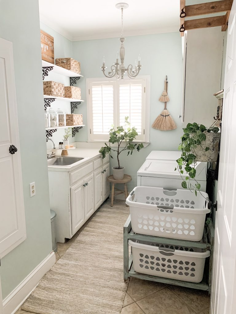 laundry room with broom wall decor