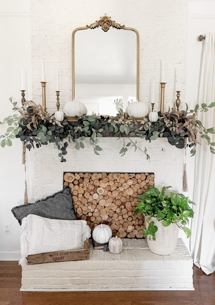 fall mantel with neutral garland and gold mirror focal point