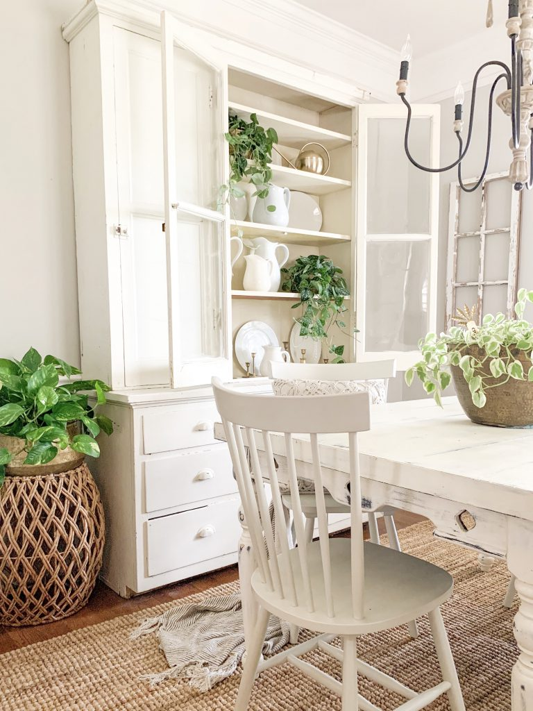 white spindle chair in dining room