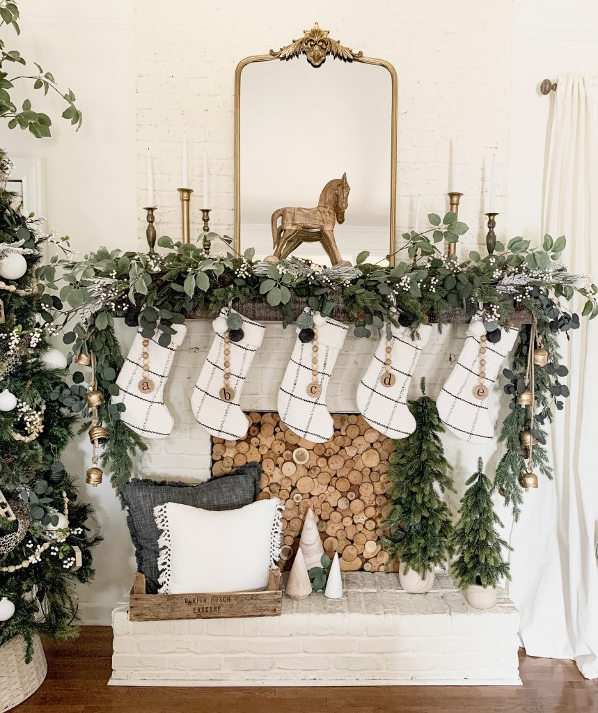 gold mirror and wood horse on Christmas mantel