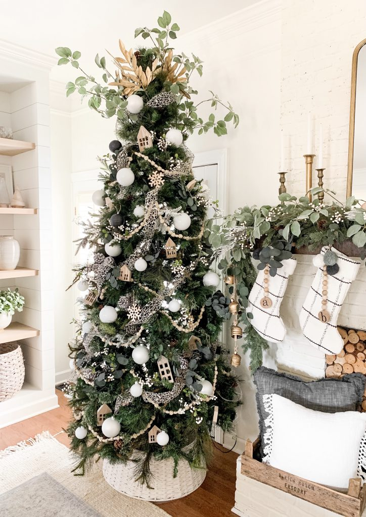 white and gold Christmas tree in living room