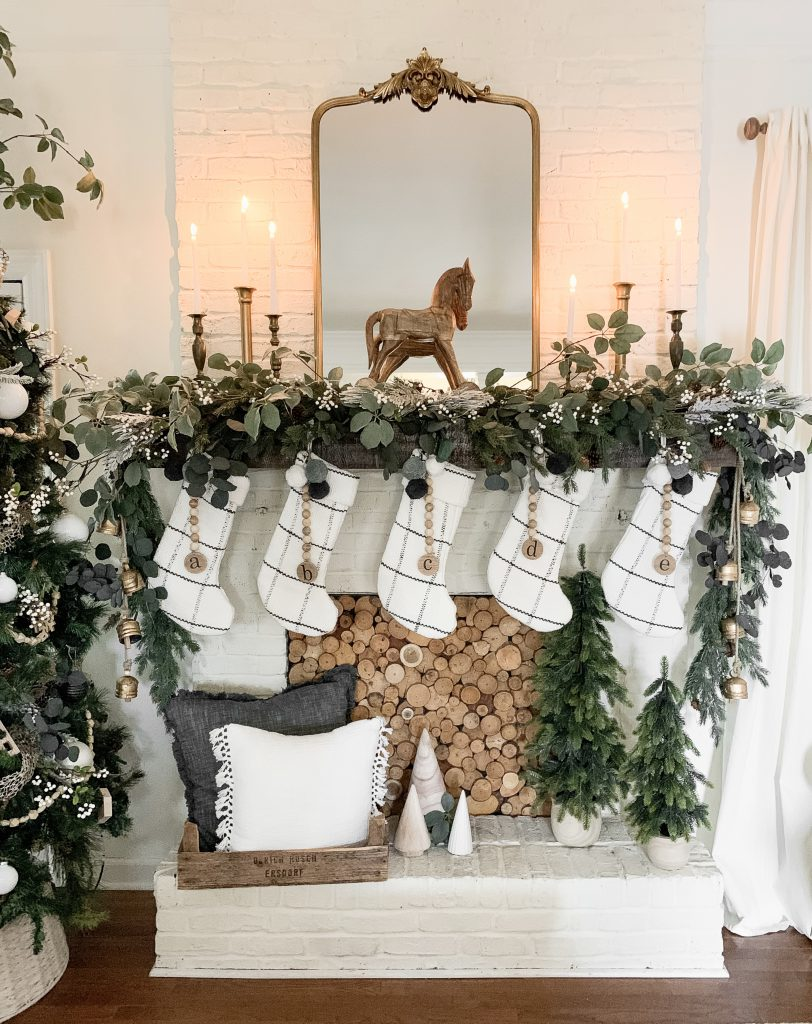 brass candlesticks on Christmas mantel