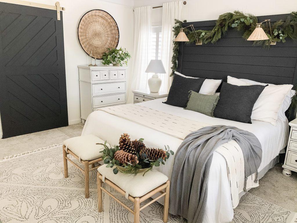 view of dark barn door and headboard in master bedroom