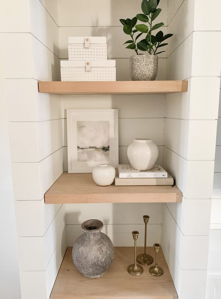 decor pieces on shelves in living room