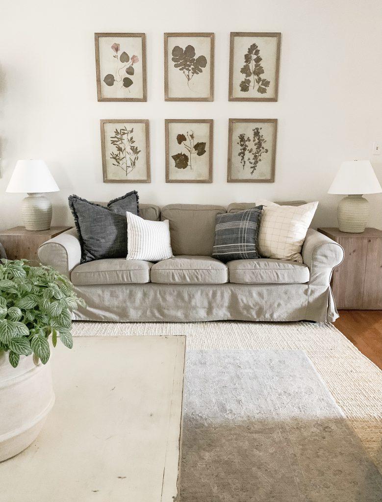 herb prints behind the sofa