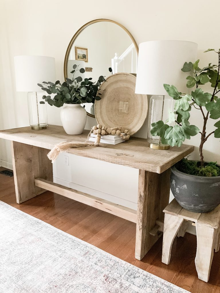 mirror and basket on entryway table